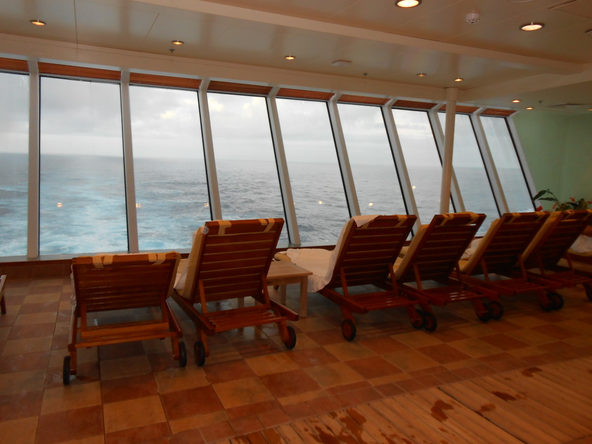 The lounge chairs that look out the back window of the cruise ship.