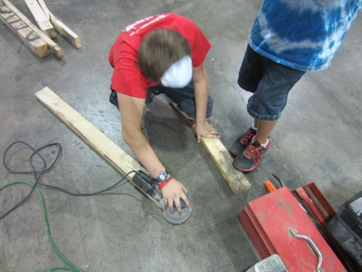 Sanding the wood.