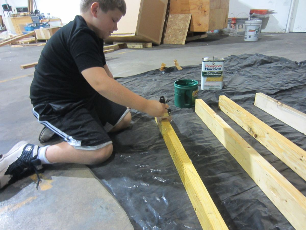Sealing the cut pieces of wood.