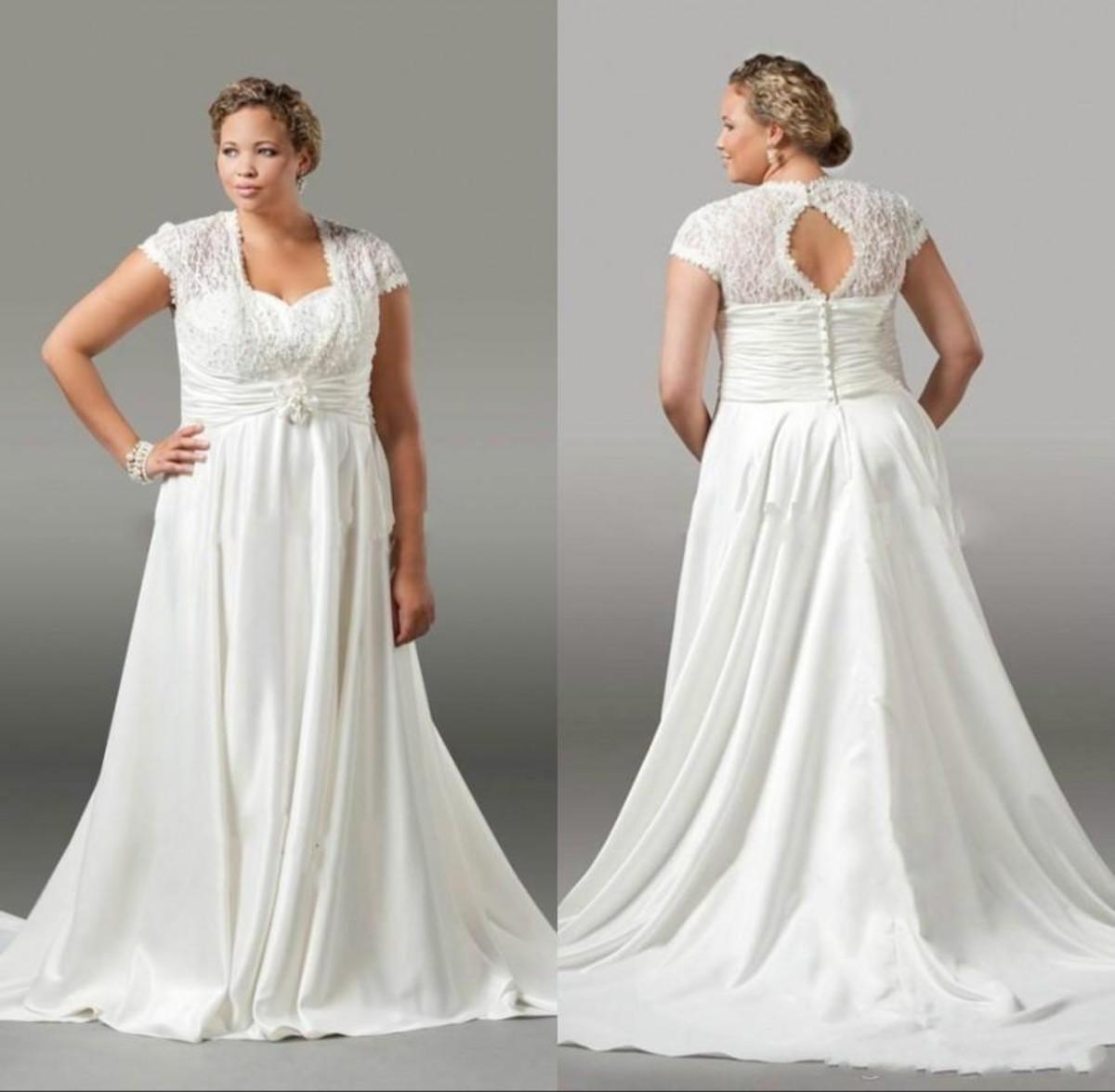 Amazing plus size wedding dress with sleeves and lace back.