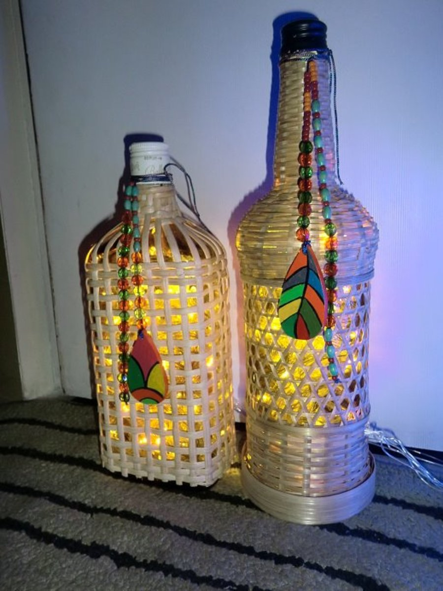 Beads and hand-painted colourful embellishments on bottle lamps