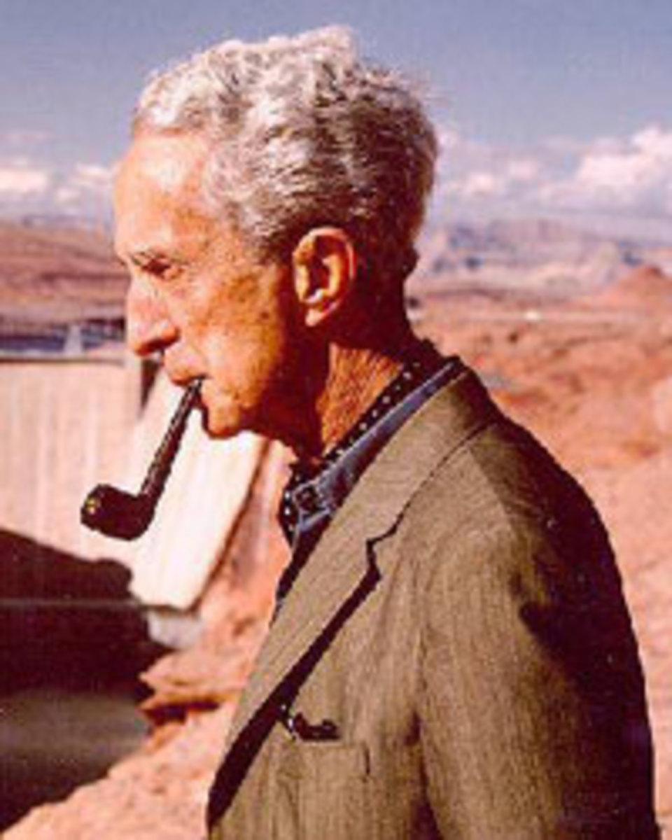 An elderly Mr. Rockwell enjoys a smoke on his pipe.