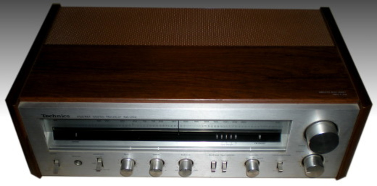 A front-top view of the solid state 1980 Technics SA-202 30 watts per channel integrated amplifier.
