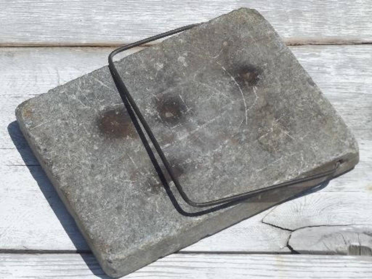 Antique soapstone foot-warming or bed-warming stone