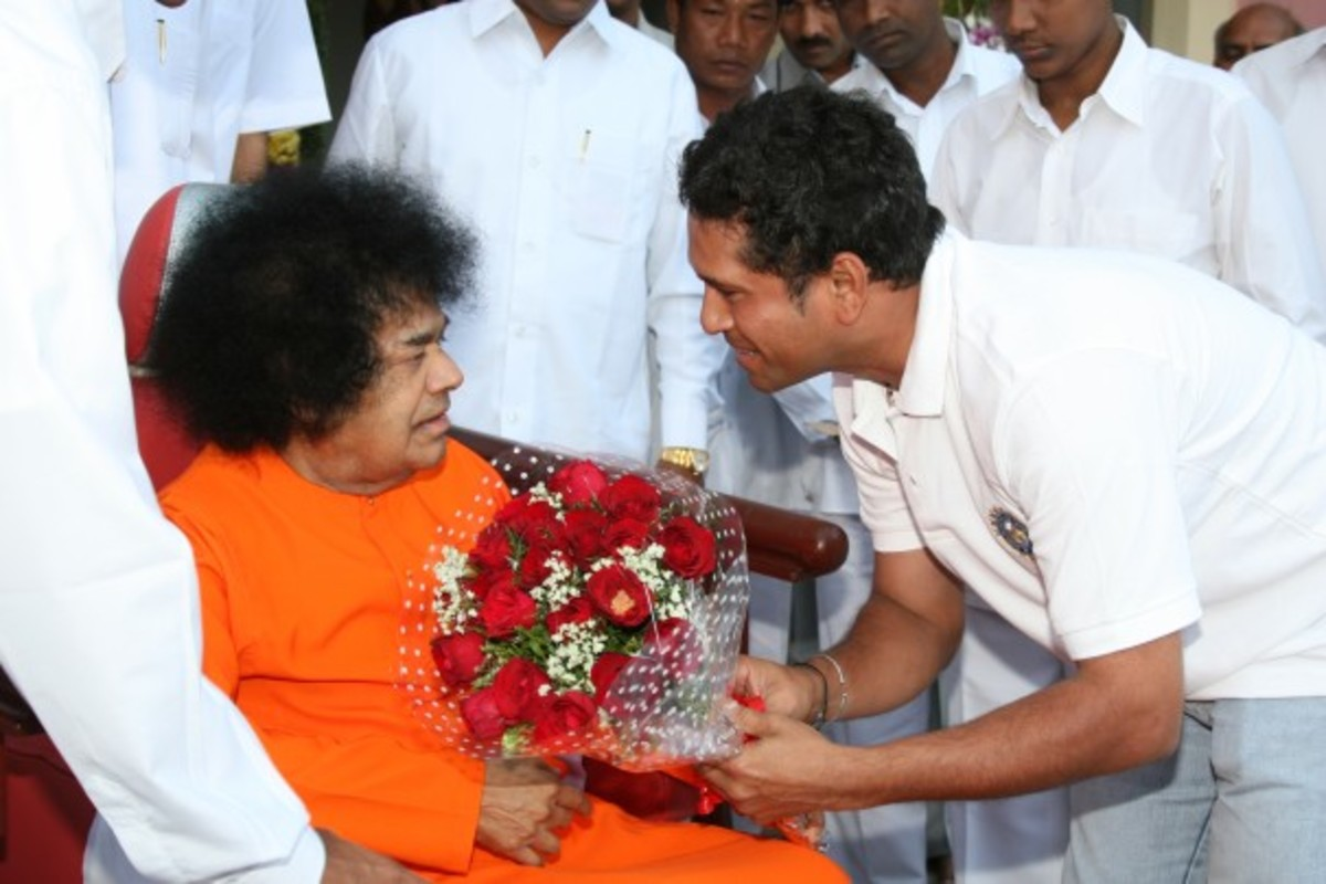 Offering a bouquet to his Guru.