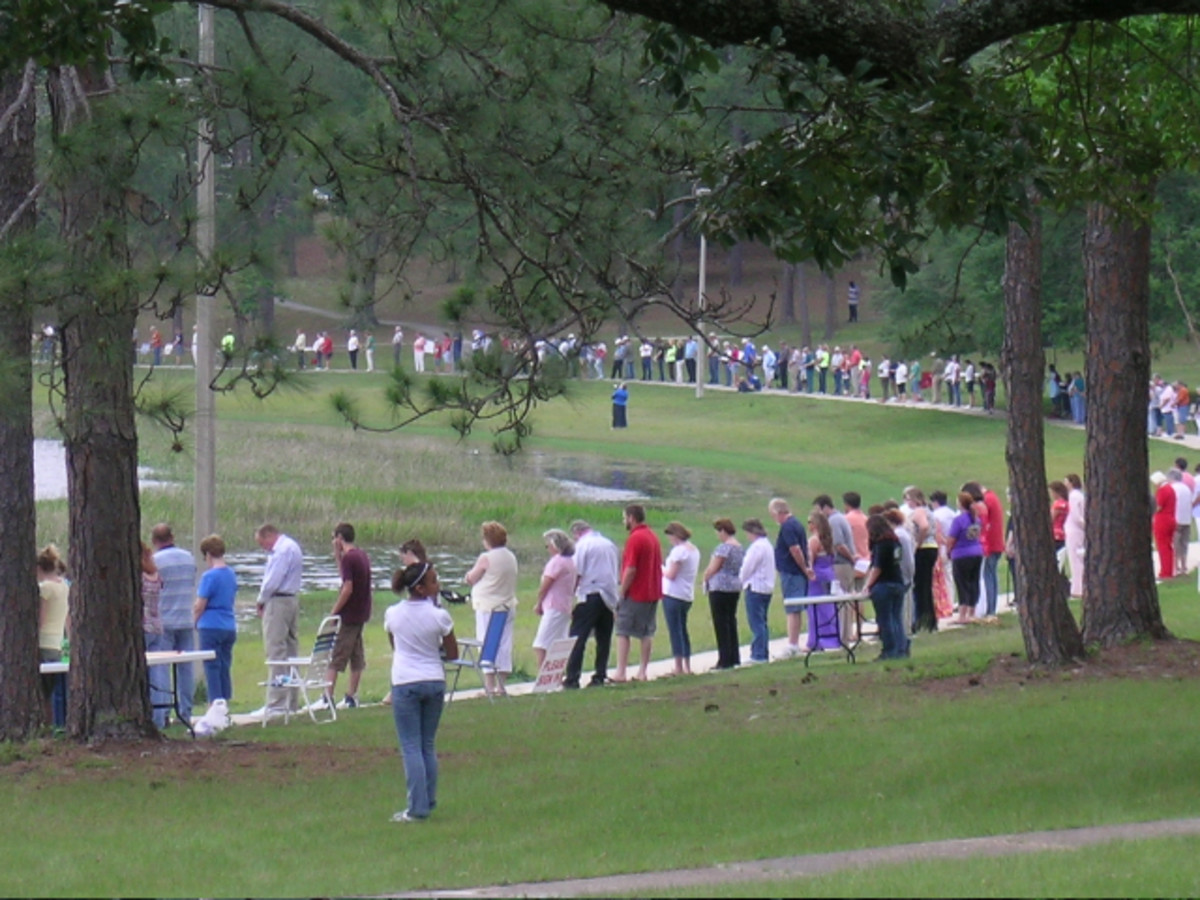 A CIRCLE OF PRAYER rings Lake DeFuniak, FL,  one of many National Day of Prayer observances seen around the area on May 7, 2009.  Lake DeFuiak boasts one of the two lakes in the world shaped as a perfect circle
