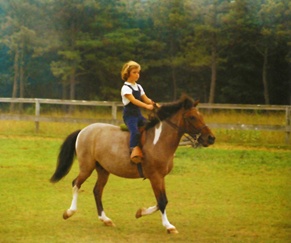 Carolina riding her horse Macaroni