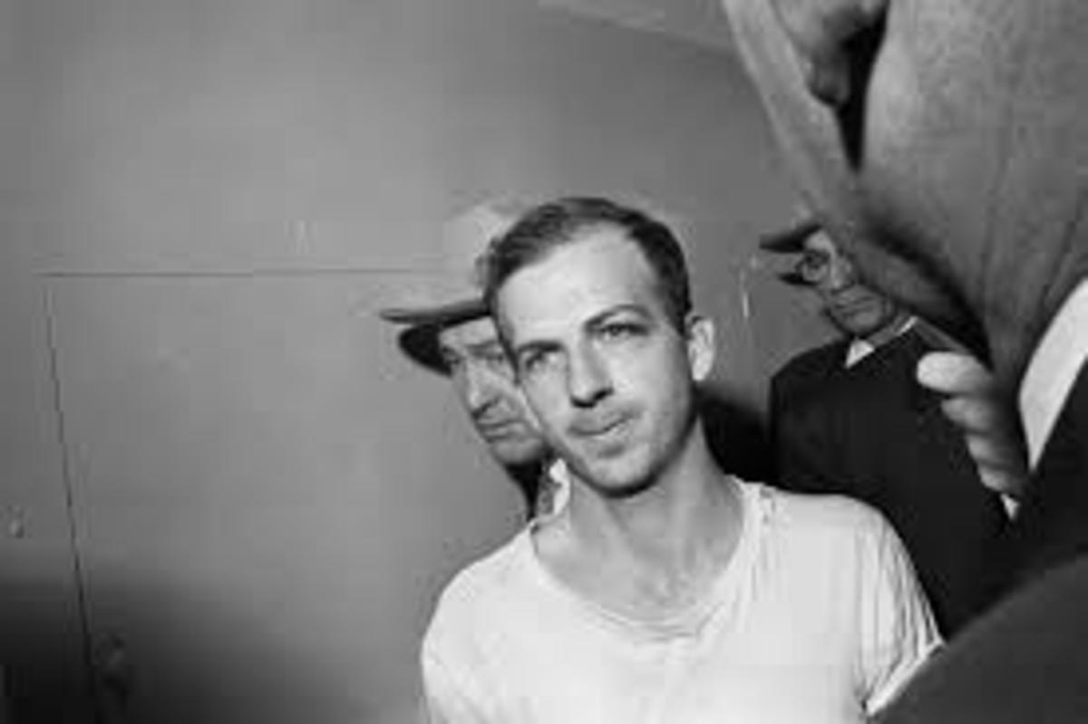 Lee Harvey Oswald in custody after shooting the President.