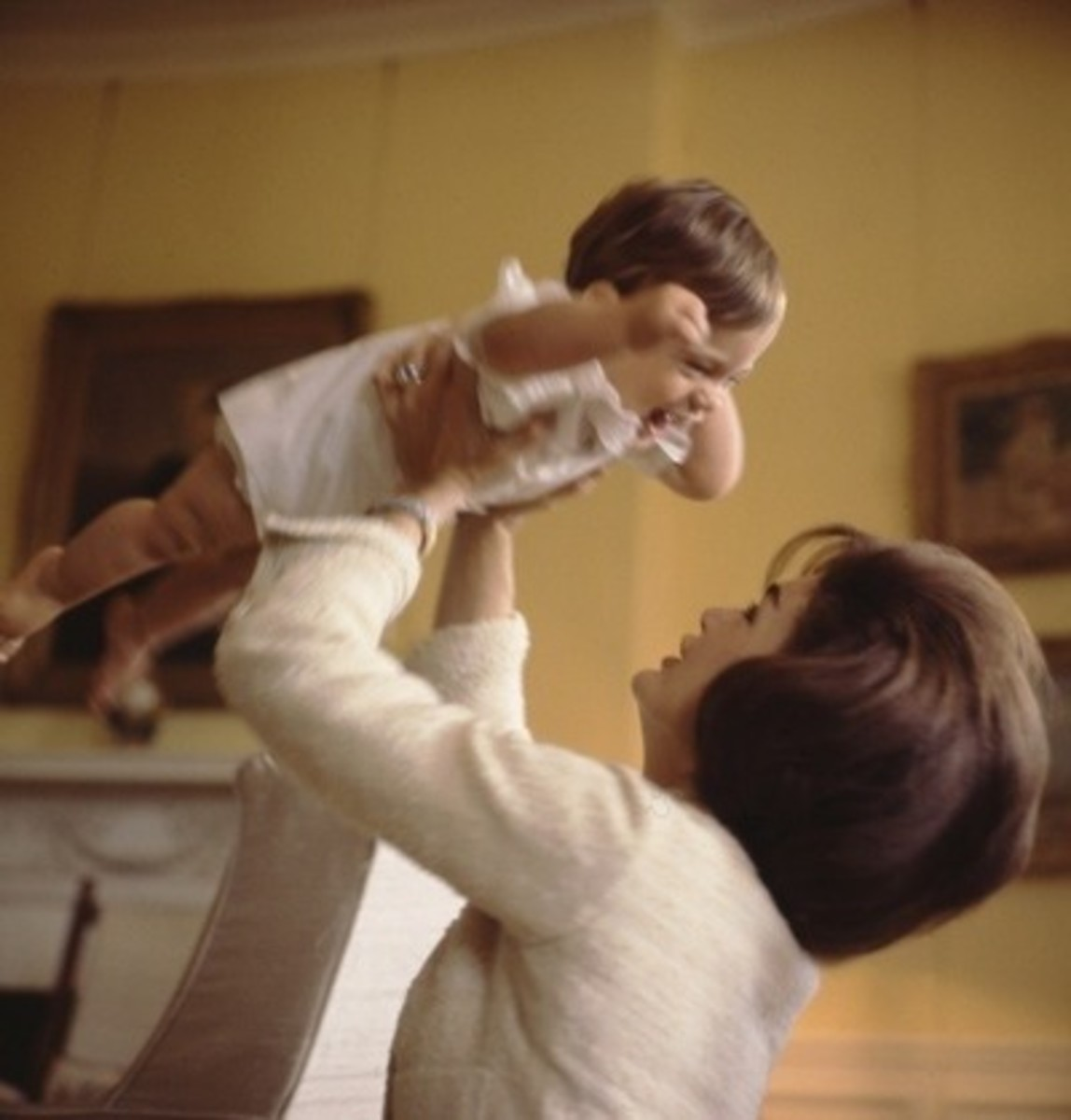 Jackie plays with baby John John