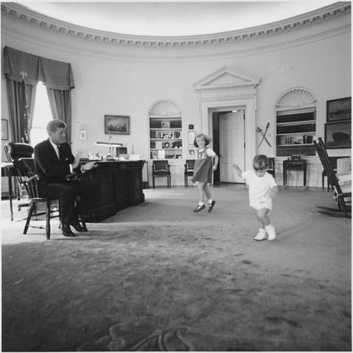 The Kennedy children visit in the Oval Office