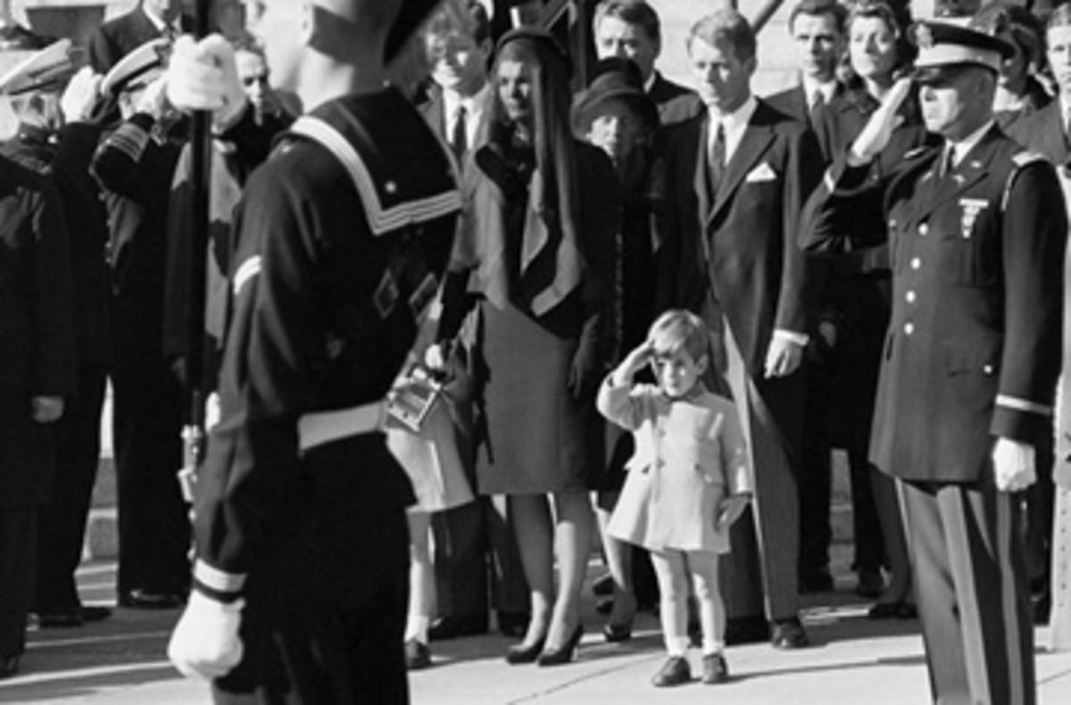 John John salutes his father's casket