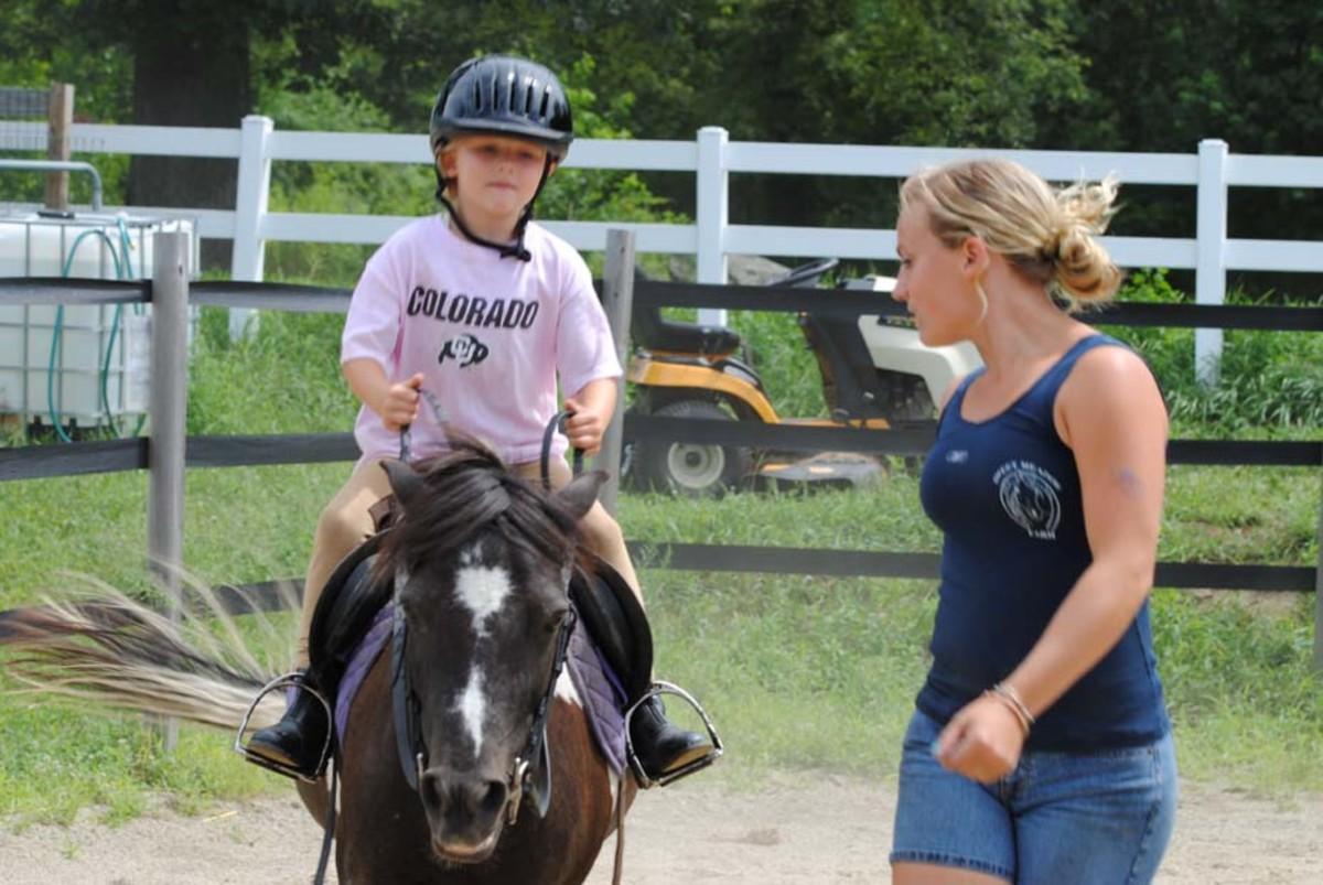 giving-horseback-riding-lessons