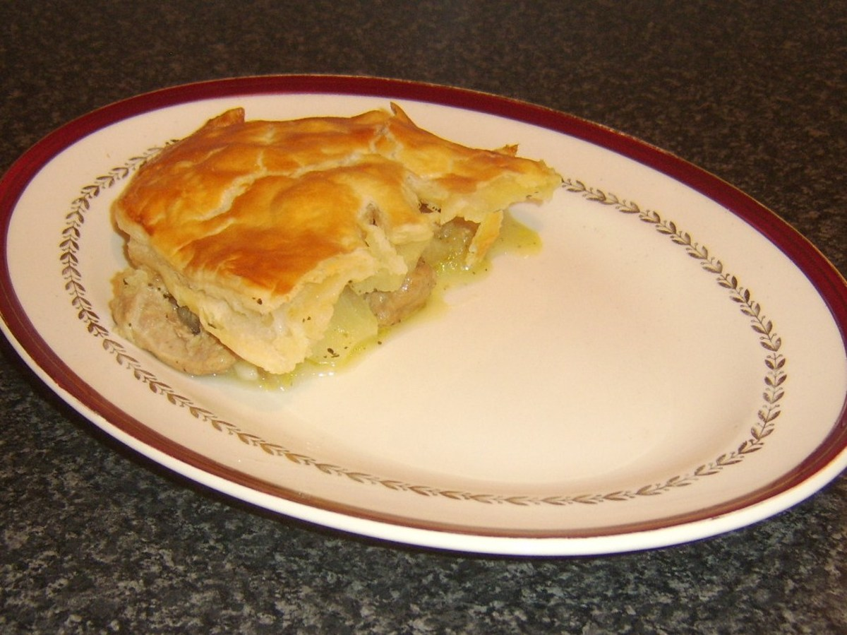 Portion of pork, pineapple and apple pie is plated