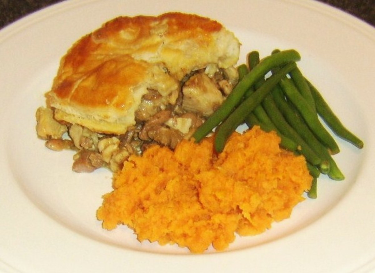 Succulent pork and turkey pie with sweet potato mash and trimmed beans