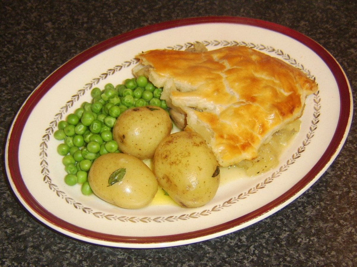 Stewed pork, apple and pineapple are incorporated in a tasty puff pastry topped pie