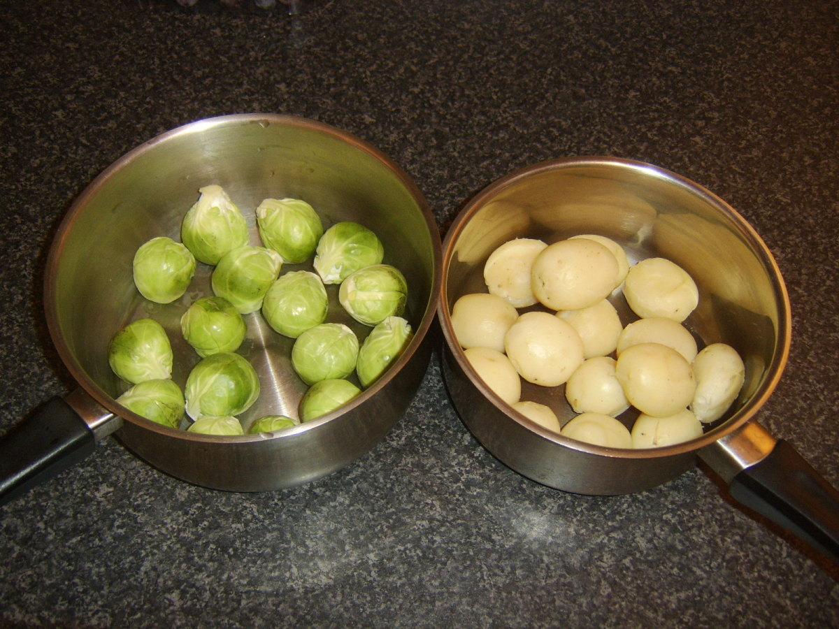 Brussels sprouts and peeled potatoes ready for final cooking touches