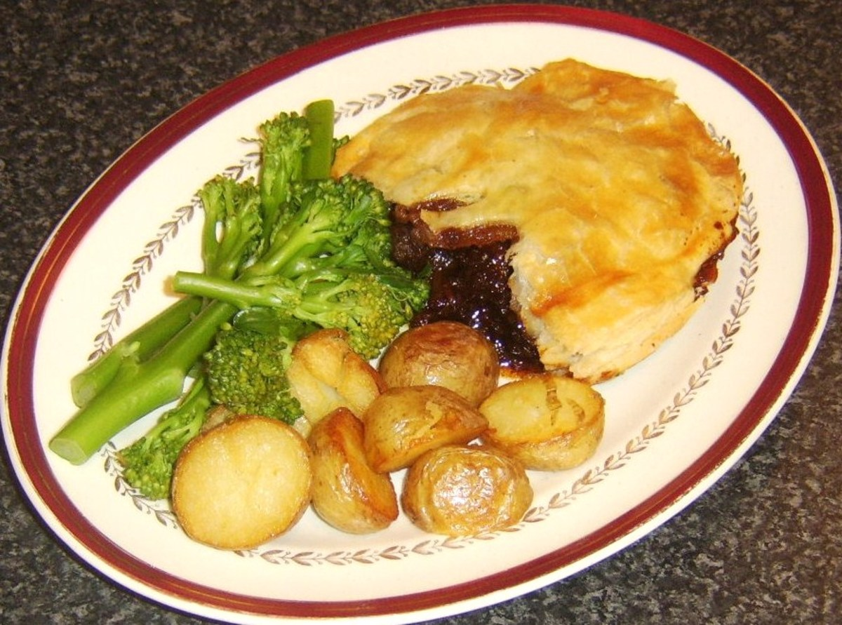 Pork and venison pie with tenderstem broccoli and roast potatoes