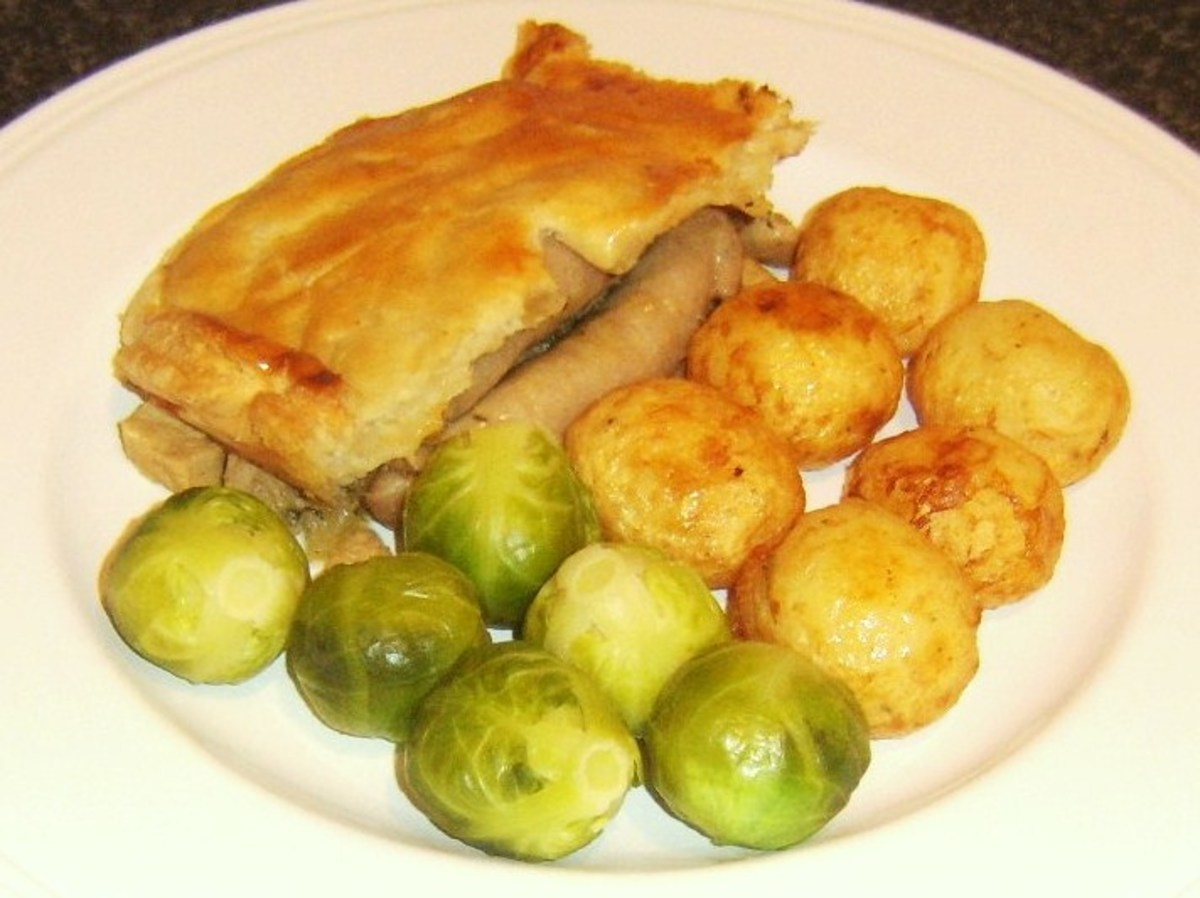 Pork meat and sausages are topped with puff pastry to form a pork equivalent of Scottish steak pie