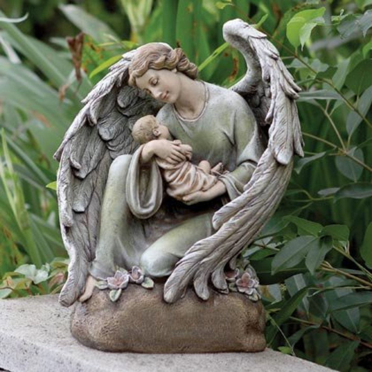 A Peacefull Angel Having A Baby in Her Arms is Your Perfect Statue To Have This Christmas
