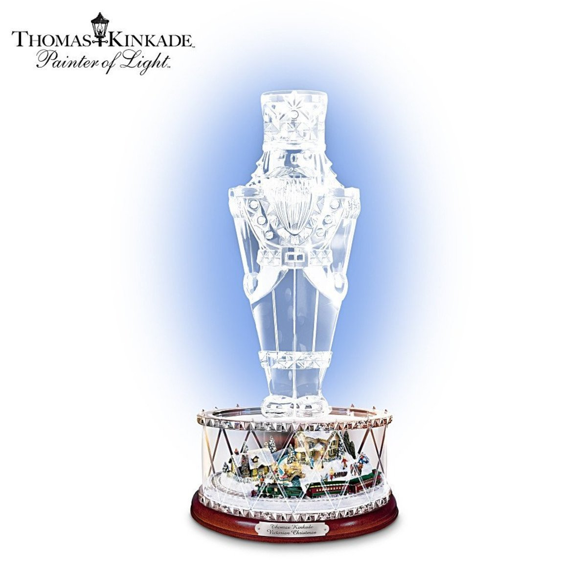 The nutcracker stands on top of a crystal drum.