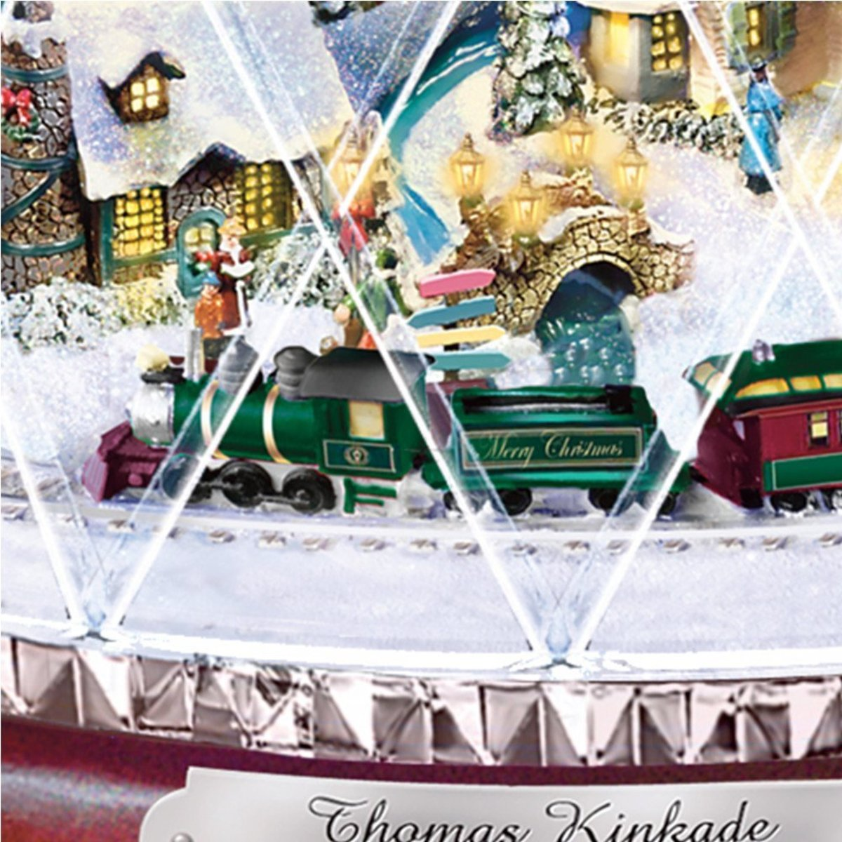 Miniature animated train circles the Christmas village.