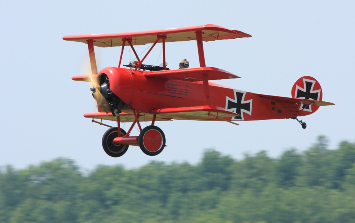 Replica Fokker DR.I Triplane painted in the same colors as the Red Baron's plane, being flown at an air show.