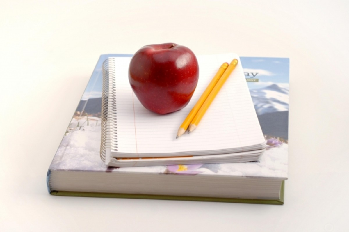 Apple and pencil on book