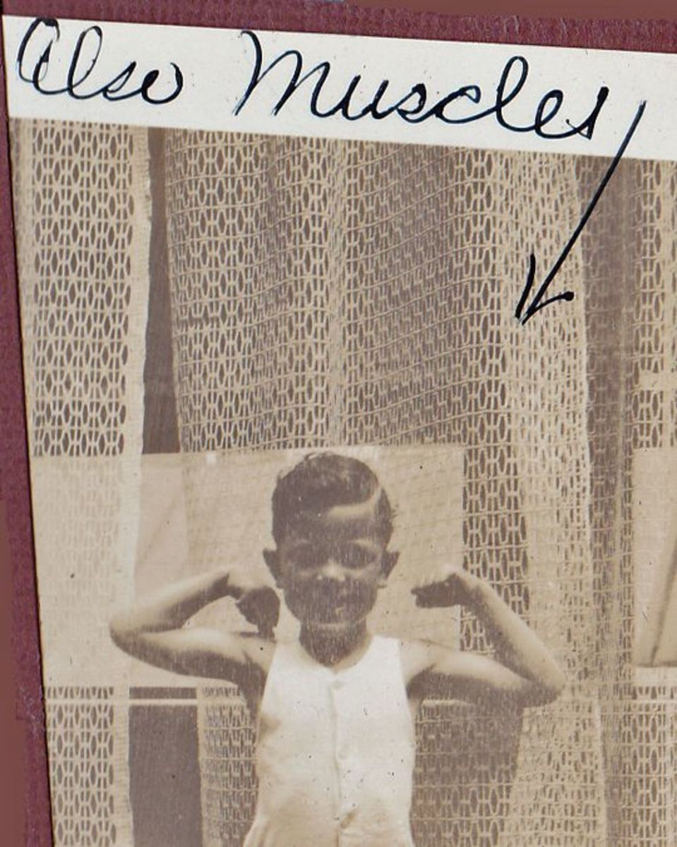 my dad as a boy showing off his 'muskels'
