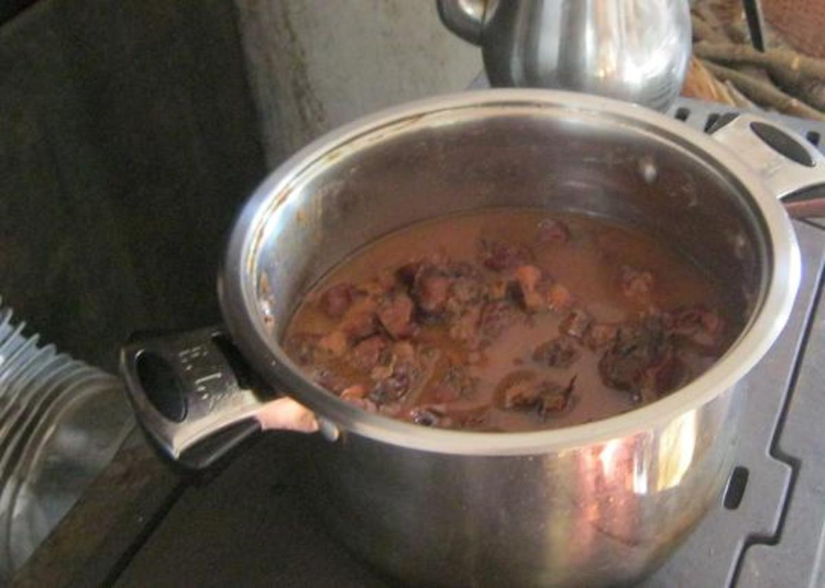Simmer the whole medlar fruits until soft - for about an hour
