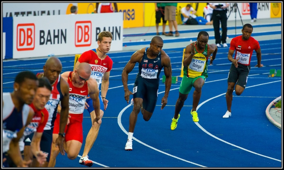 Gold-medal Olympian sprinter Shawn Crawford. Very muscular, and genetically thin legs.