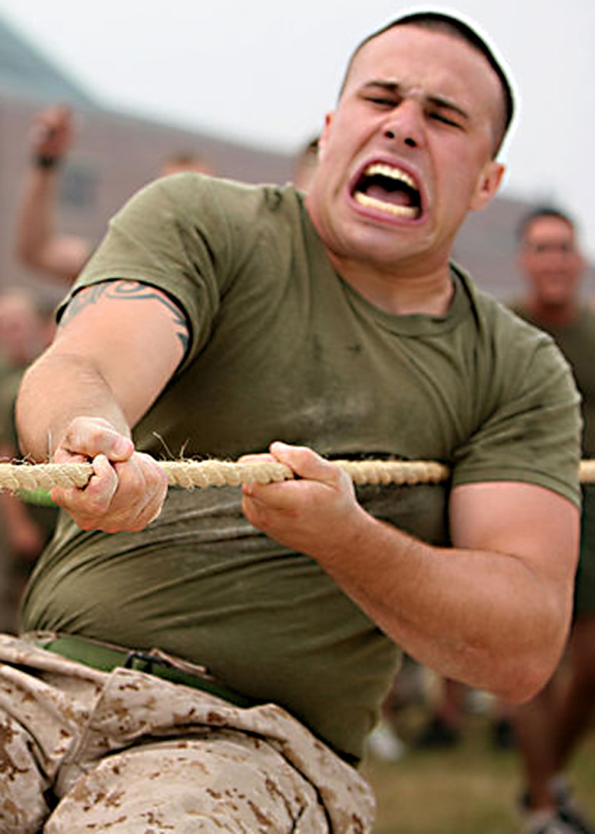 Tug of War as a form of tough, yet friendly competition, is popular with military forces. Here, Cpl. Joshua McDermott, of Combat Logistics Regiment 27, shows true grit and determination during one pull