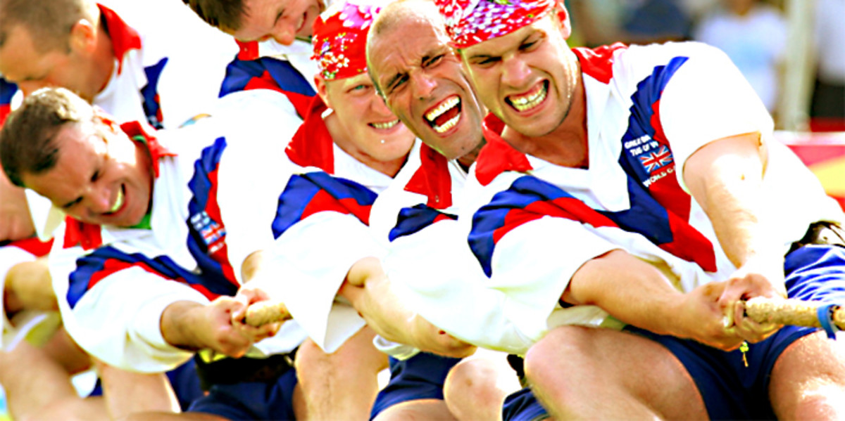 British Bronze medalists at the World Games in 2009. Anyone who doubts that tug of war can be a tough, physically demanding sport, only has to look at the expressions on the faces. In some sports, Olympic Gold can be won with less determination