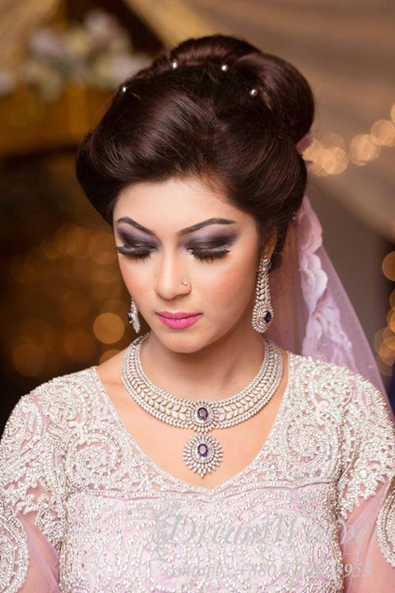 A bride with shades of purple and mauve.