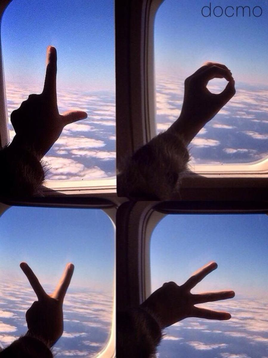 While flying back from a recent holiday, my adorable daughter Anna suggested signing the letters L.O.V.E against the gorgeous sky outside - the rest, as they say, is photography.