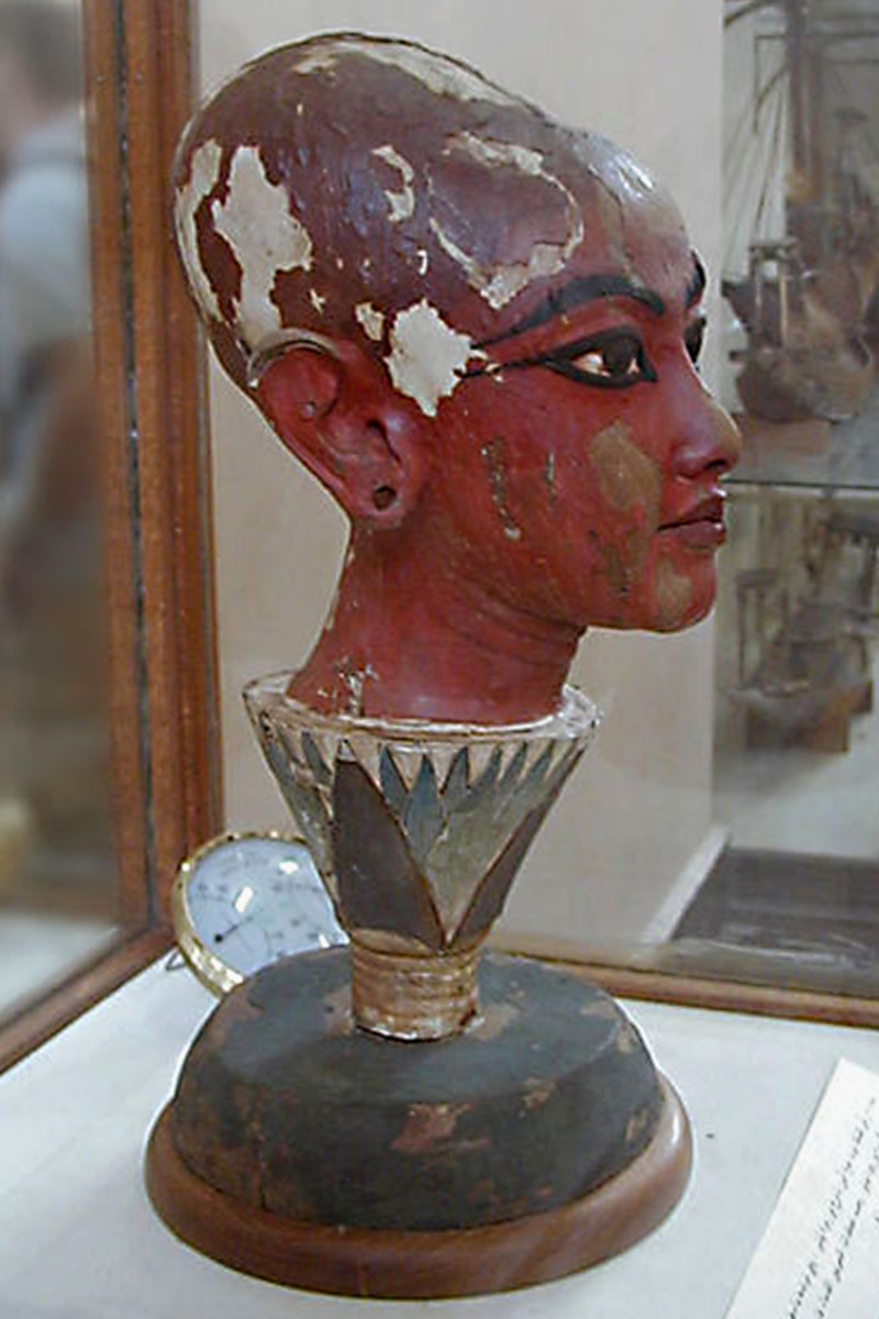 An ancient scupture of Tutankamun found in his tomb in Egypt. The head stands in a vase ornamented with the design of the Blue Lotus flower
