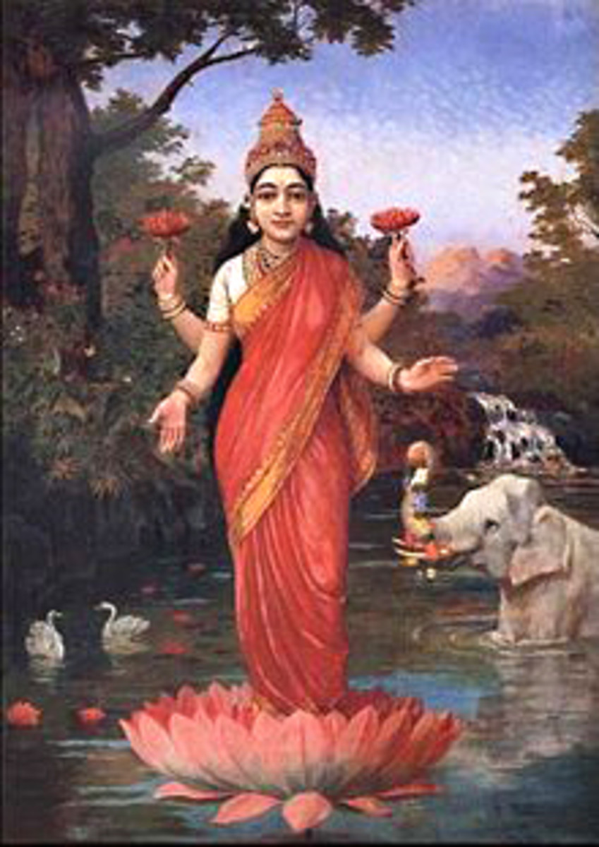 The Hindu goddess Lakshmi holding two Sacred Lotus blossoms and standing on a floating Lotus Flower