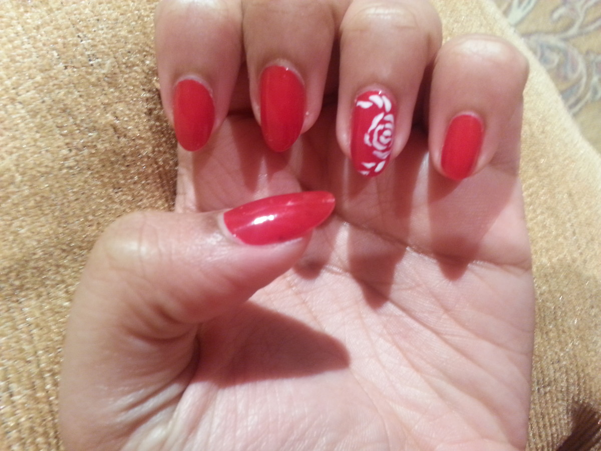 Red Romance Nail Art done by Suzanne Lobo