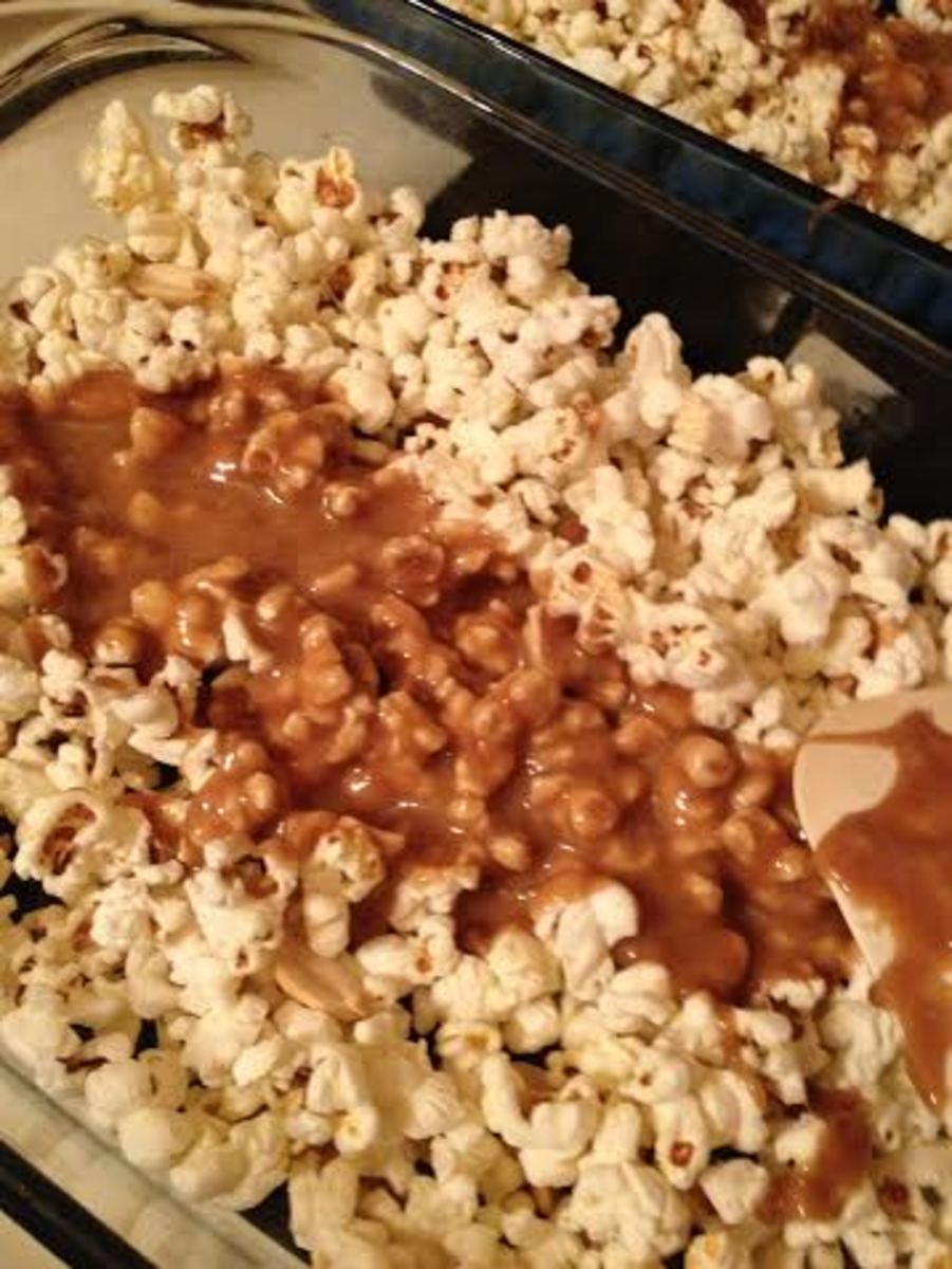 Pour the caramel over the popcorn.