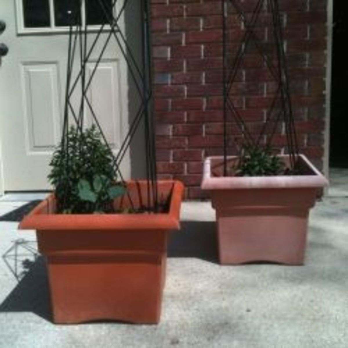 Don't sent faded plastic planters to a landfill! Make your pots look new again.