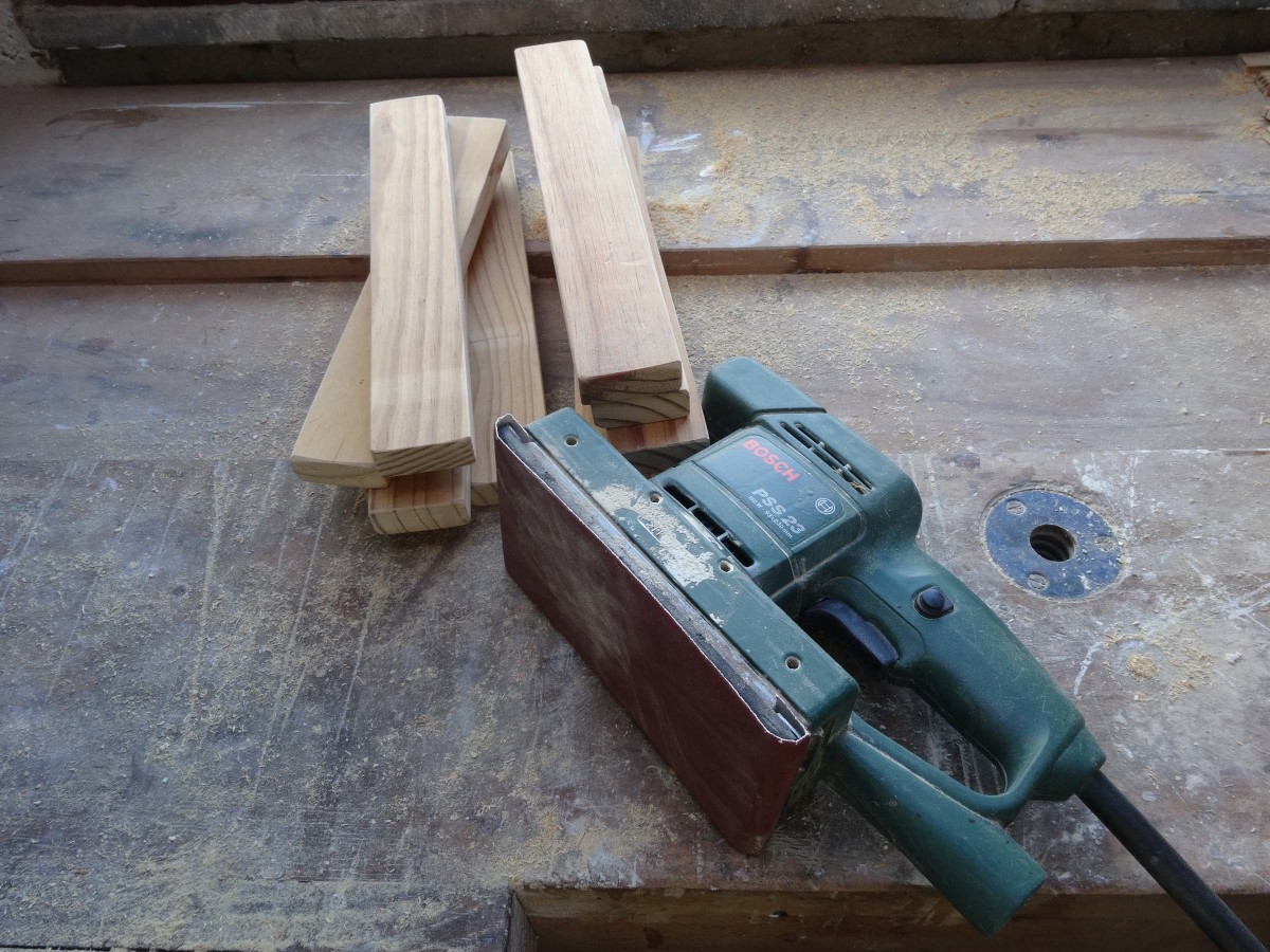 Using an ordinary sander to smooth all the shelf supports.