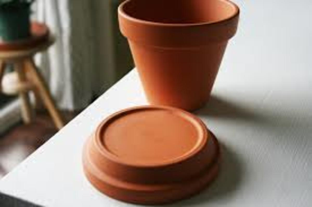 Clay pot and small saucer