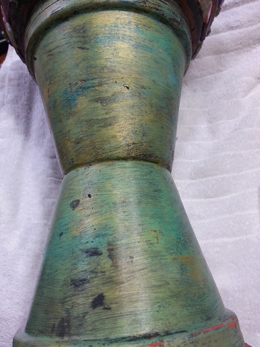 Painted clay pots glued together.