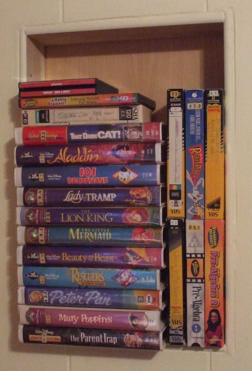 Kids' VHS tapes in a wall nook right by the VCR/DVD player.