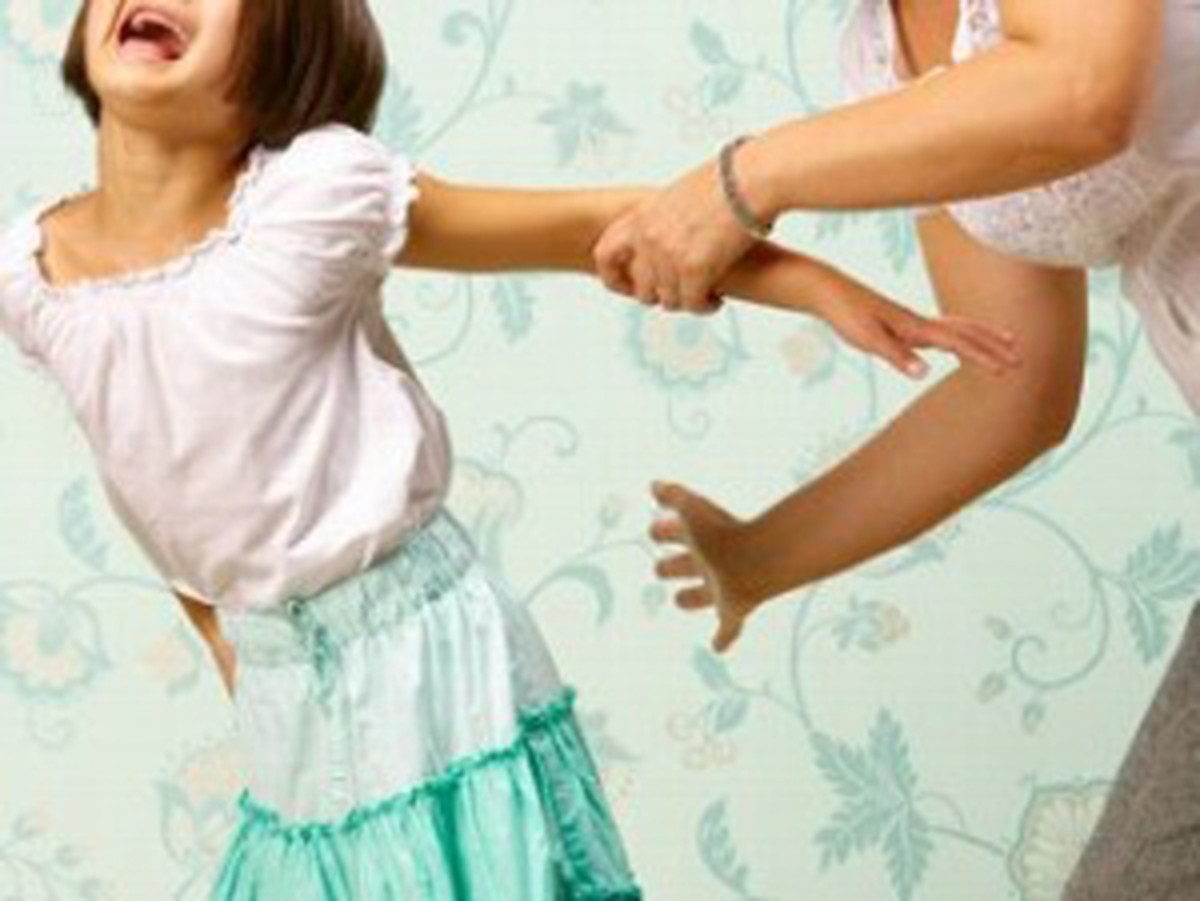 parent spanking young daughter for saying bad words