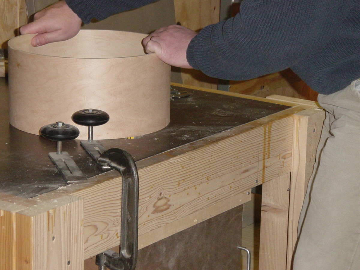 Carefully routering the bearing edges of a drum shell on a home made router table.