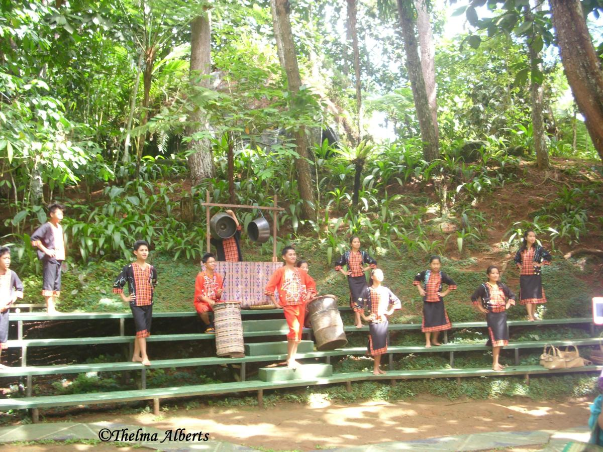 Local dancers performing their traditional dance for the tourists.
