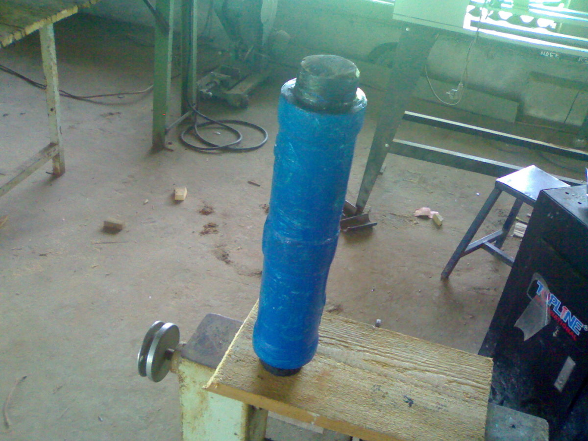 Already casted and coated cylinder in Foundry workshop