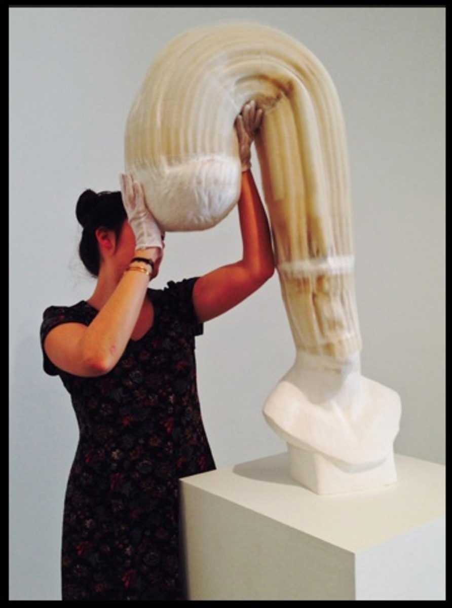 All 6 Photos demonstrating Li Hongbo's sculptures are provided by Beyond Chinatown on Flickr.