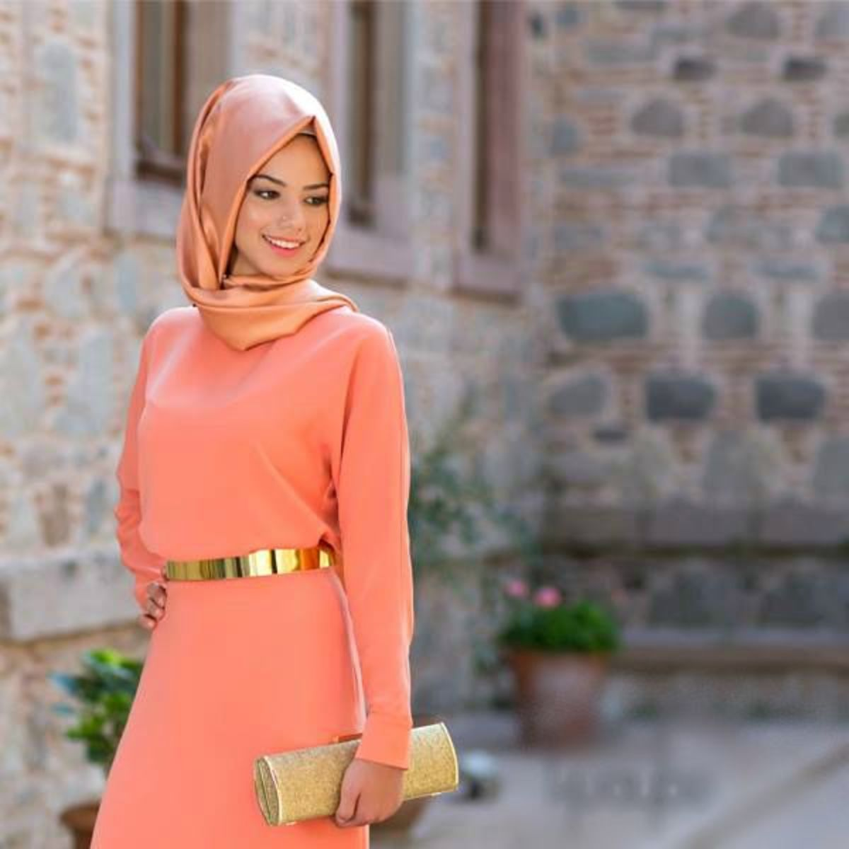 Woman in Hijab wearing Peach maxi dress