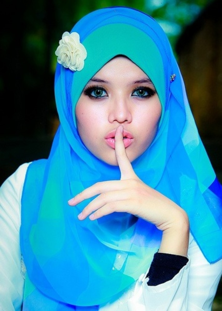 Blue and Green scarf with flower accessory.